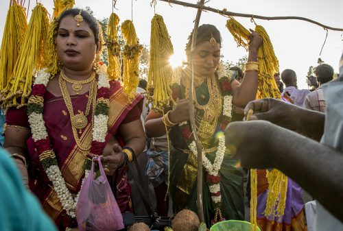 Aravanis dressed traditionally and selecting the thali yellow thread for the wedding,villupuram,India